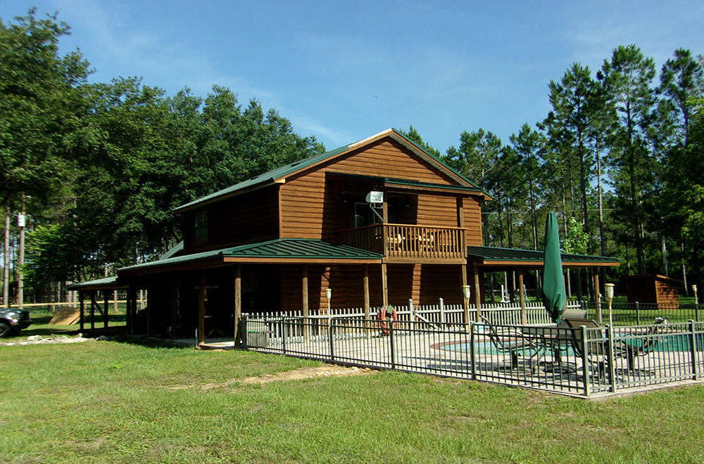Forest Green Standing Seam Metal Roof On Log Home
