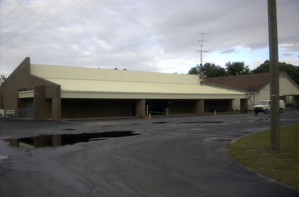 Metal Roof Over A Gravel Roof On A School In Dade City